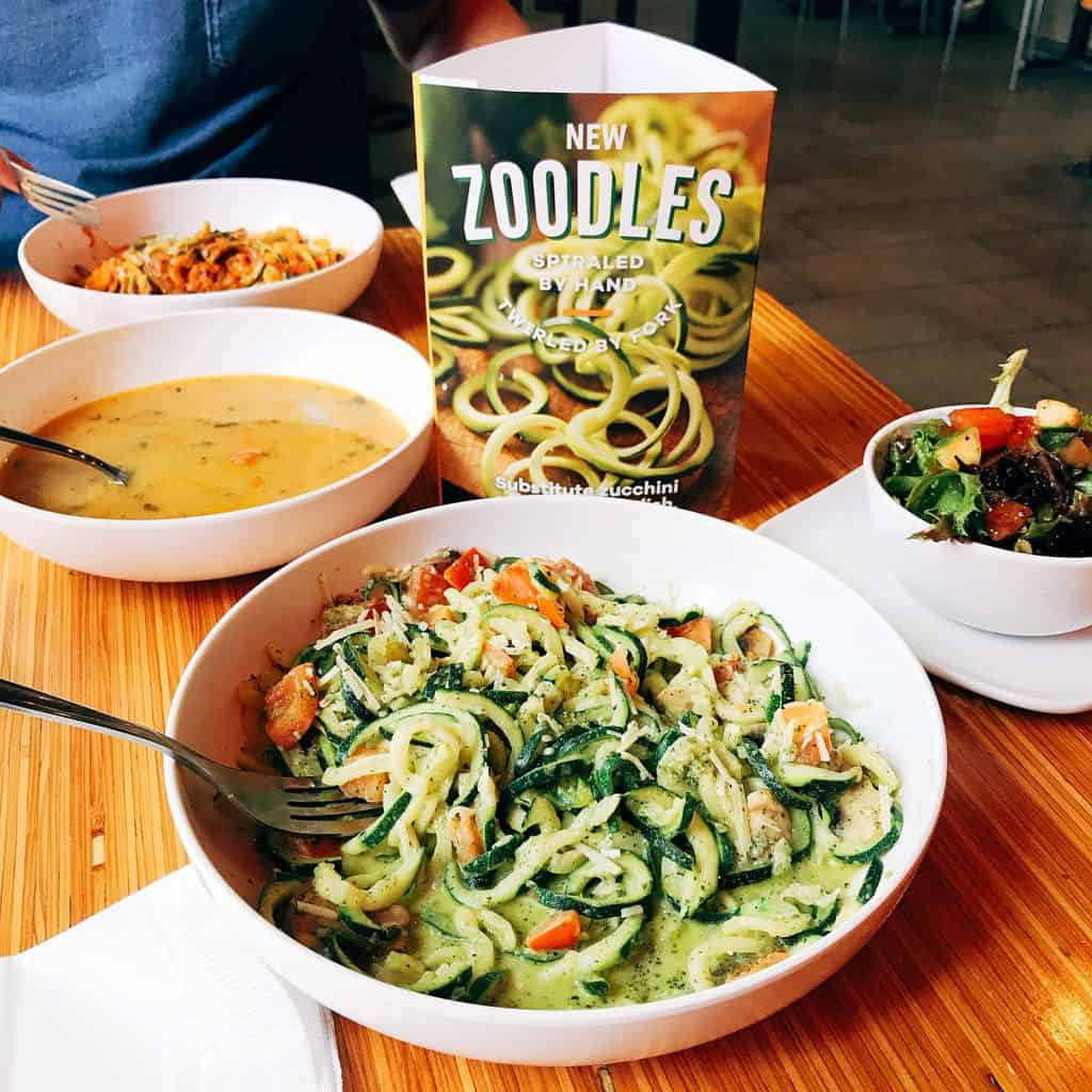 Image of two pasta meals where the noodls have been swapped out for zoodles, aka zucchini noodles, as a healthier option.
